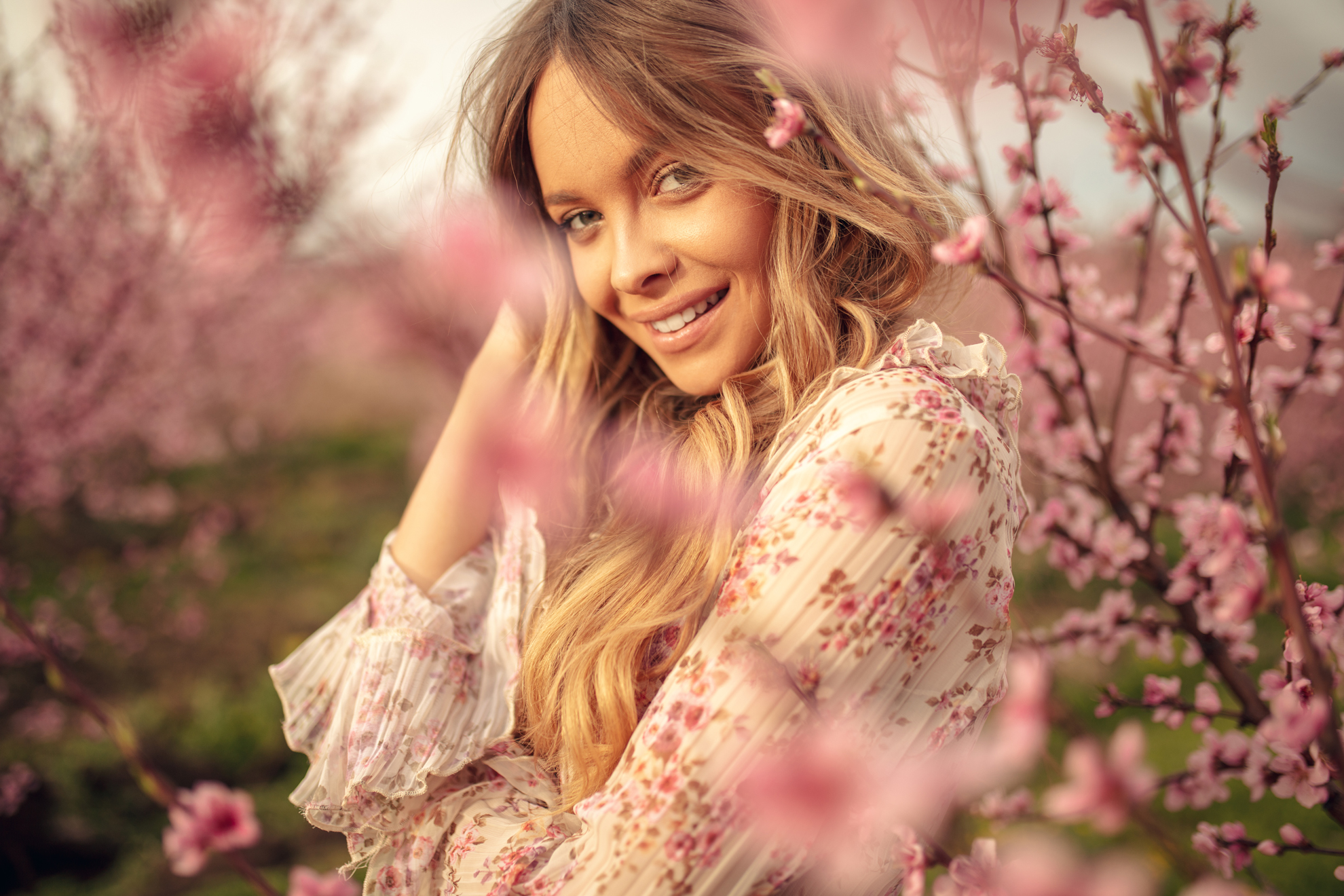Young woman under Cherry Blossom